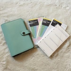 FiloFAX planner! Comes with a bunch of inserts